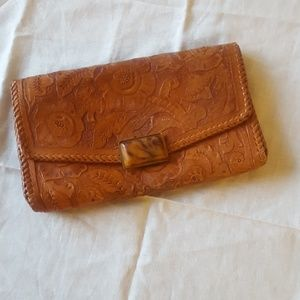 Flower engraved leather clutch
